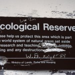 Eco reserve sign on side of lookout building near E. R. boundary - Below Sunbeam Cr. Ecological Reserve, near McBride, BC June 1991 - Art Carson photo