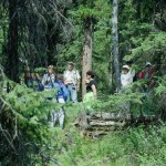 Field trip participants explore the reserve's forest