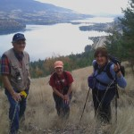 Three ER wardens on the steep grassland hills.