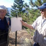 Laurie Rockwell and Garry Fletcher at one of the Ecological Reserve signs.