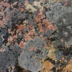 Red Feldspar rock with lichen