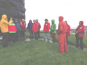 Damp, but enthusiastic members of the 2014 Race Rocks field trip listening to Eco-guardian Courtney Edwards.